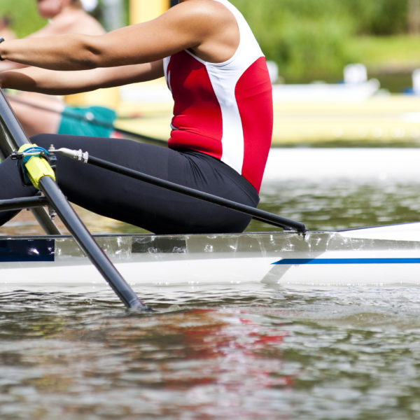 Woman Single sculls rower during the start of a rowing regatta